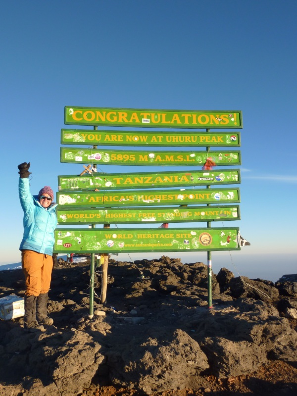 The Hutch's Andrea Towlerton stands on the tallest peak in Africa.