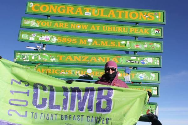 Christine Fisher summits Mt. Kilimanjaro. Photo courtesy of Christine Fisher.